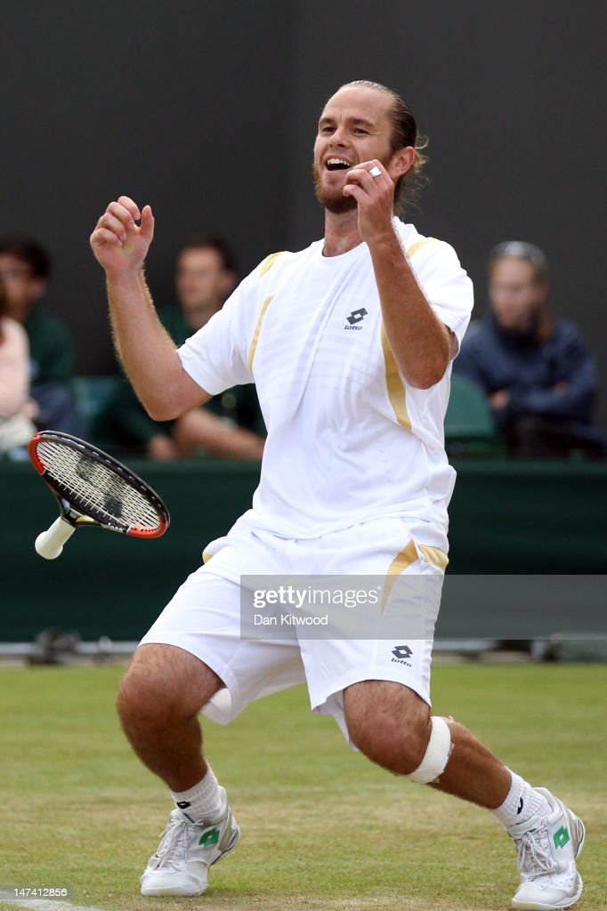 Xavier Malisse of Belgium celebrates match point during his Gentlemen's Singles third round match against Fernando Verdasco of Spain on day five of the Wimbledon Lawn Tennis Championships at the All England Lawn Tennis and Croquet Club on June 29, 2012 in London, England.