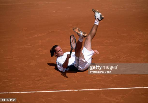 Xavier Malisse of Belgium falling on the clay court during the French Open Tennis Championships at the Stade Roland Garros circa May 2003 in Paris...