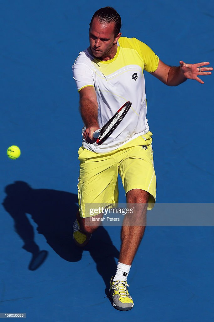 Xavier Malisse of Belgium plays a backhand during his first round match against Martin Kilzan of Slovakia during day one of the Heineken Open at ASB Tennis Centre on January 7, 2013 in Auckland, New Zealand.