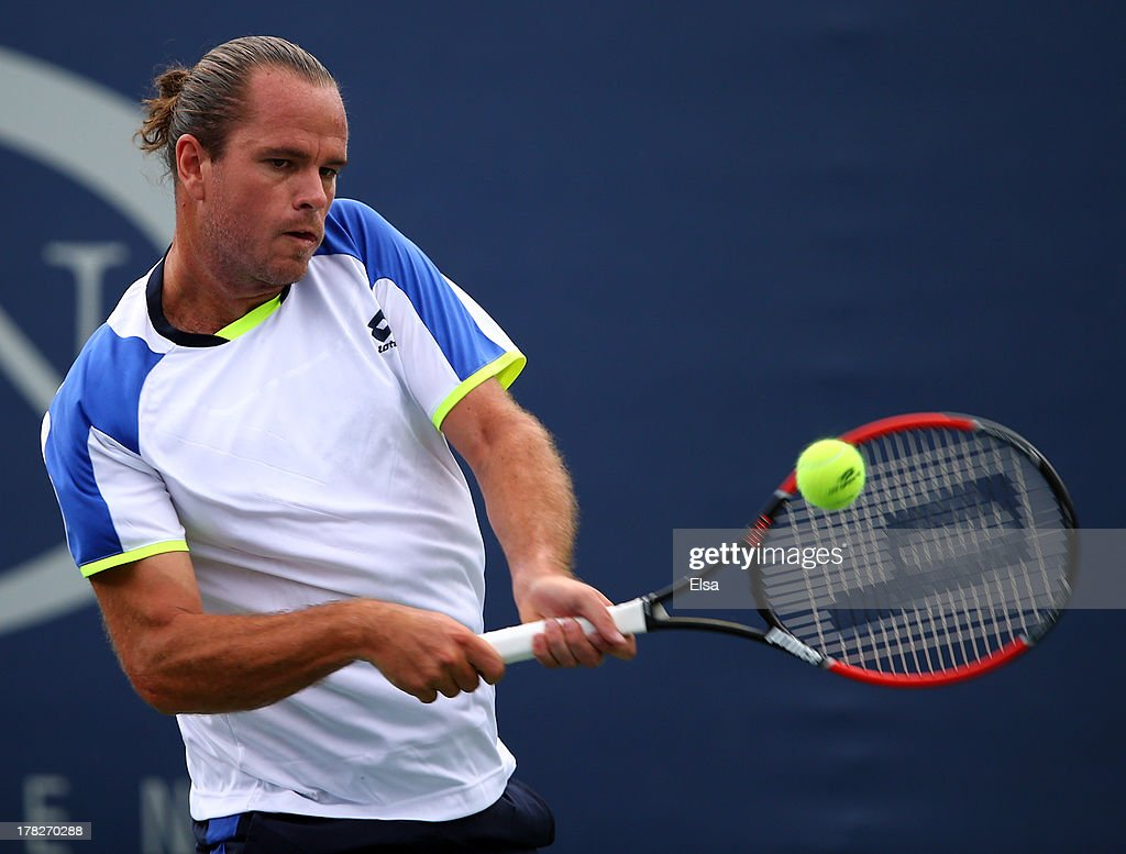 Xavier Malisse of Belgium plays a backhand during his men's singles first round match against Andreas Seppi of Italy on Day Three of the 2013 US Open at USTA Billie Jean King National Tennis Center on August 28, 2013 in the Flushing neighborhood of the Queens borough of New York City.