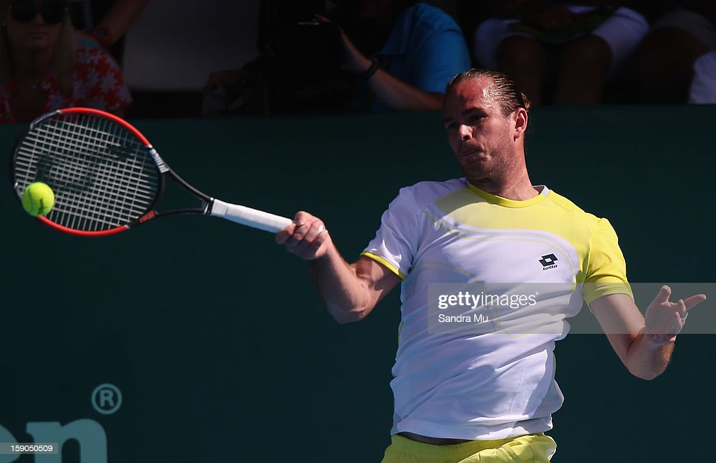Xavier Malisse of Belgium plays a backhand in his first round match against Martin Kilzan of Slovakia during day one of the Heineken Open at ASB Tennis Centre on January 7, 2013 in Auckland, New Zealand.