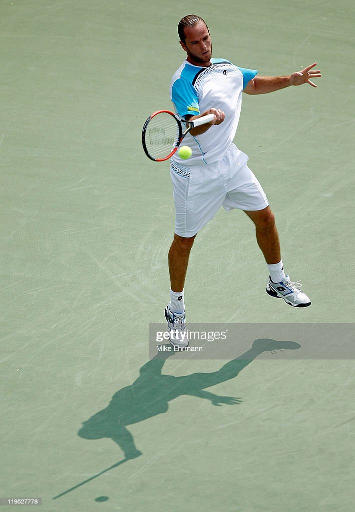 Xavier Malisse of Belgium plays a forehand during a match against Ryan Harrison at the Atlanta Tennis Championships at the Racquet Club of the South on July 21, 2011 in Atlanta, Georgia.