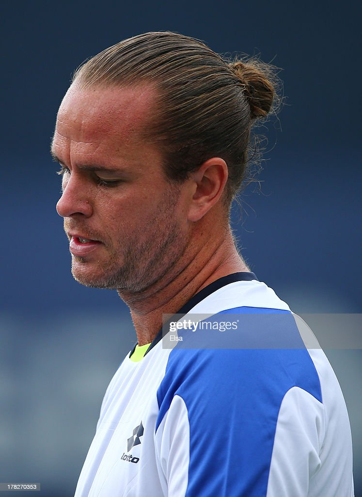 Xavier Malisse of Belgium reacts during his men's singles first round match against Andreas Seppi of Italy on Day Three of the 2013 US Open at USTA Billie Jean King National Tennis Center on August 28, 2013 in the Flushing neighborhood of the Queens borough of New York City.