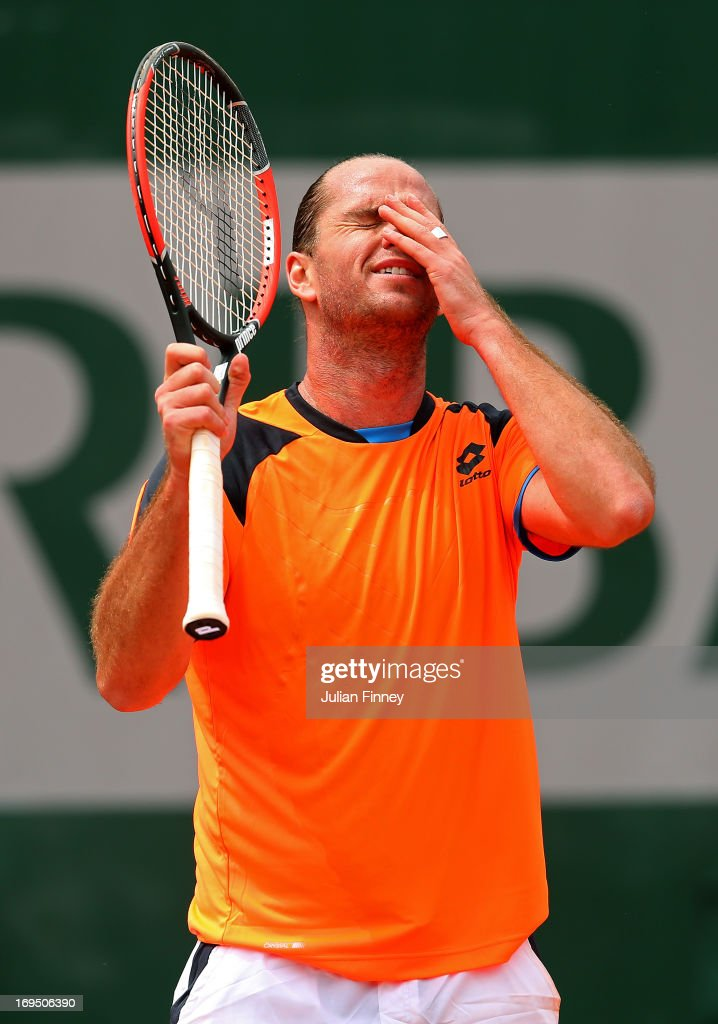 Xavier Malisse of Belgium reacts during his men's singles match against Milos Raonic of Canada on day one of the French Open at Roland Garros on May 26, 2013 in Paris, France.