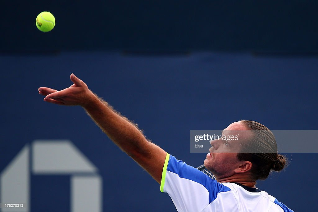 Xavier Malisse of Belgium serves during his men's singles first round match against Andreas Seppi of Italy on Day Three of the 2013 US Open at USTA Billie Jean King National Tennis Center on August 28, 2013 in the Flushing neighborhood of the Queens borough of New York City.
