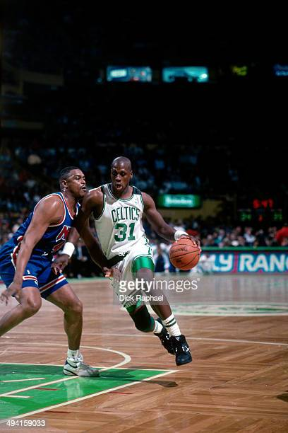 Xavier McDaniel of the Boston Celtics drives against Rick Mahorn of the New Jersey Nets during a game played at the Boston Garden in Boston...