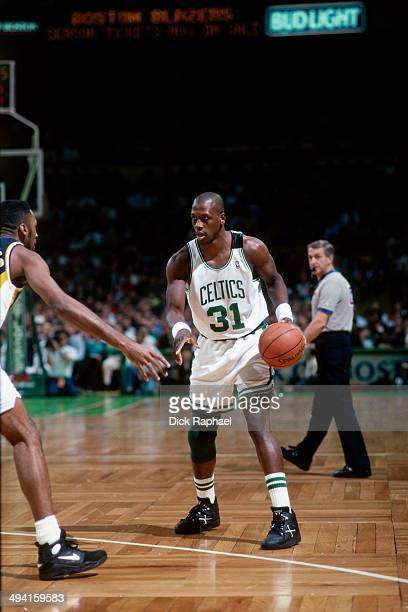 Xavier McDaniel of the Boston Celtics handles the ball against the Indiana Pacers during a game played at the Boston Garden in Boston Massachusetts...