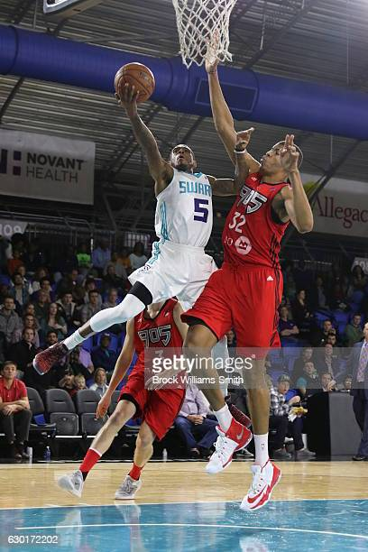 Xavier Munford of the Greensboro Swarm goes up for the basket against Edy Tavares of the Toronto Raptors during the game at the The Field House at...