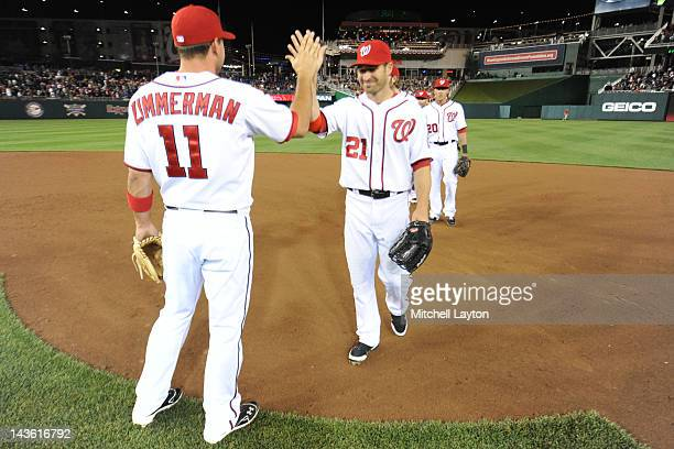 Xavier Nady and Ryan ZImmerman of the Washington Nationals celebrate a win after a baseball game against the Miami Marlins at Nationals Park on April...