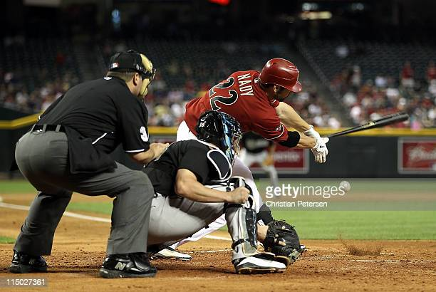 Xavier Nady of the Arizona Diamondbacks hits a RBI on a fielding error by the Florida Marlins during the seventh inning of the Major League Baseball...