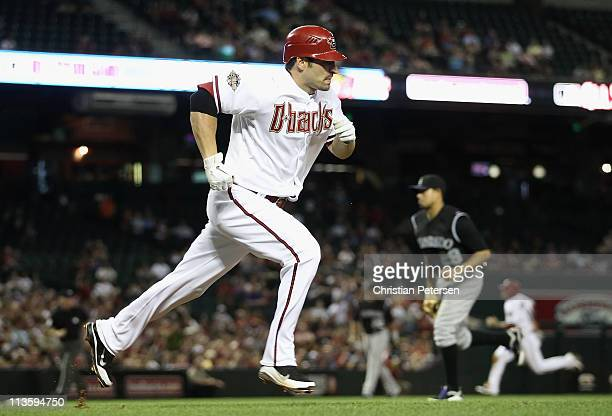 Xavier Nady of the Arizona Diamondbacks runs to first base after hitting a two RBI single off pitcher Jorge De La Rosa of the Colorado Rockies during...