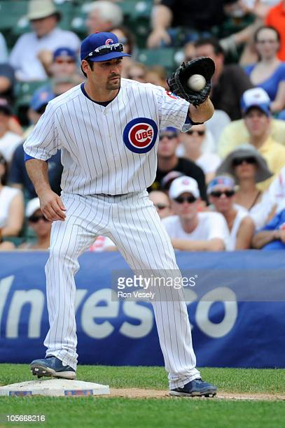 Xavier Nady of the Chicago Cubs fields during the game between the Atlanta Braves and the Chicago Cubs on Friday August 20 at Wrigley Field in...