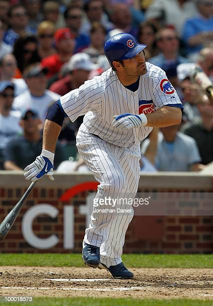 Xavier Nady of the Chicago Cubs runs after hitting the ball against the Pittsburgh Pirates at Wrigley Field on May 14 2010 in Chicago Illinois The...
