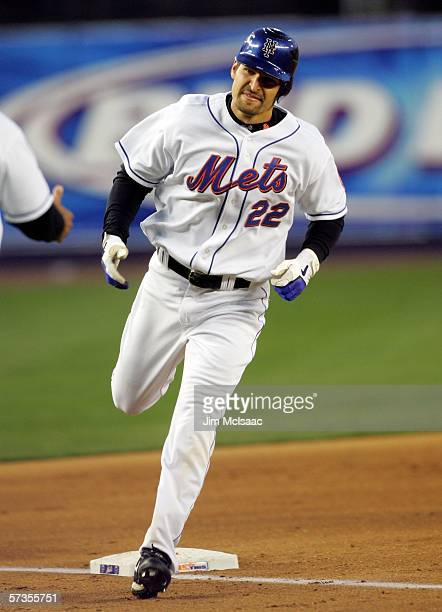 Xavier Nady of the New York Mets smiles as he rounds third base after hitting a home run against the Atlanta Braves on April 17 2006 at Shea Stadium...