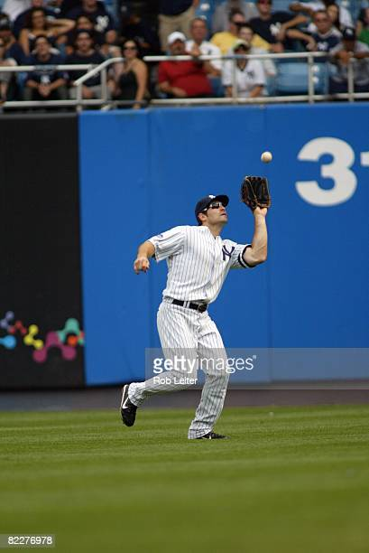 Xavier Nady of the New York Yankees catches a fly ball during the game against the Baltimore Orioles at Yankee Stadium in the Bronx New York on July...