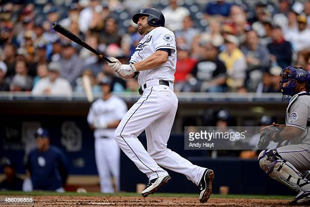 Xavier Nady of the San Diego Padres hits a home run against the Colorado Rockies at Petco Park on April 17 2014 in San Diego California