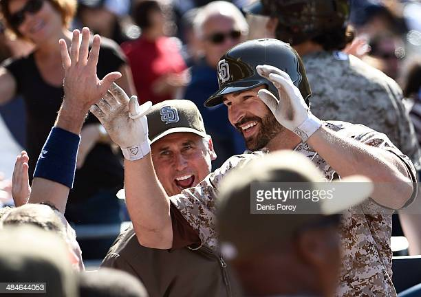 Xavier Nady of the San Diego Padres is congratulated after hitting a solo home run during the seventh inning of an interleague baseball game at Petco...