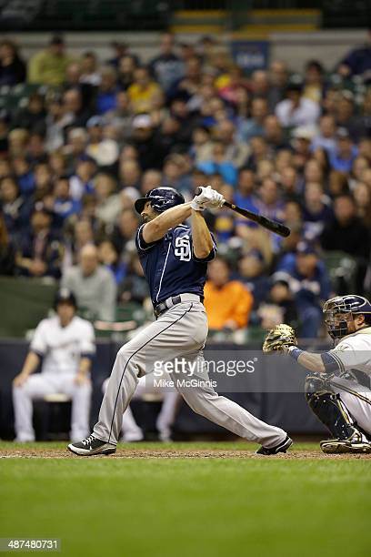 Xavier Nady of the San Diego Padres makes doe contact at the plate during the game against the Milwaukee Brewers at Miller Park on April 23 2014 in...