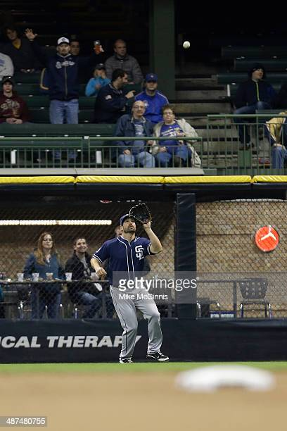 Xavier Nady of the San Diego Padres makes the catch in right field to retire Aramis Ramirez of the Milwaukee Brewers during the bottom of the eighth...