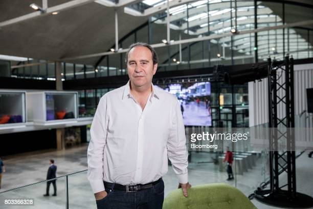Xavier Niel billionaire and cochief operating officer of Iliad SA poses for a photograph following a Bloomberg Television interview in Paris France...