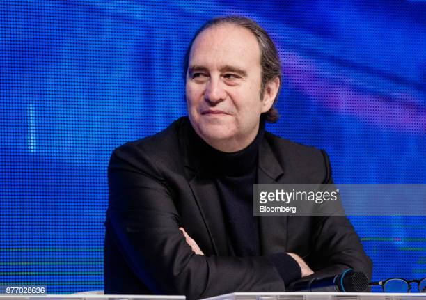 Xavier Niel billionaire and deputy chairman of Iliad SA reacts during the Rendezvous de Bercy economic debate at the French Ministry of Economy in...