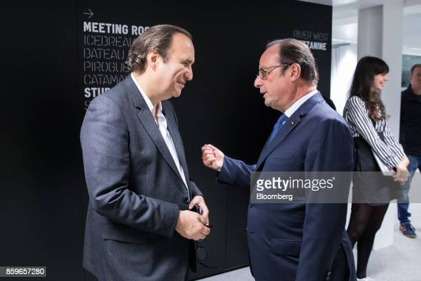 Xavier Niel billionaire and vice chairman of Iliad SA left speaks to Francois Hollande France's former president inside the Station F startup campus...