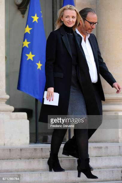 Xavier Niel chief executive officer of Free and his wife Delphine Arnault leave the Elysee Palace where Bill and Melinda Gates receiving the award of...