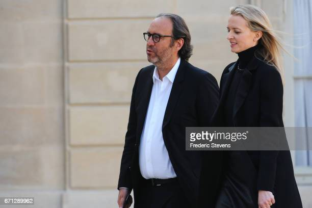 Xavier Niel chief executive officer of Free and his wife Delphine Arnault arrive at the Elysee Palace where Bill and Melinda Gates receiving the...