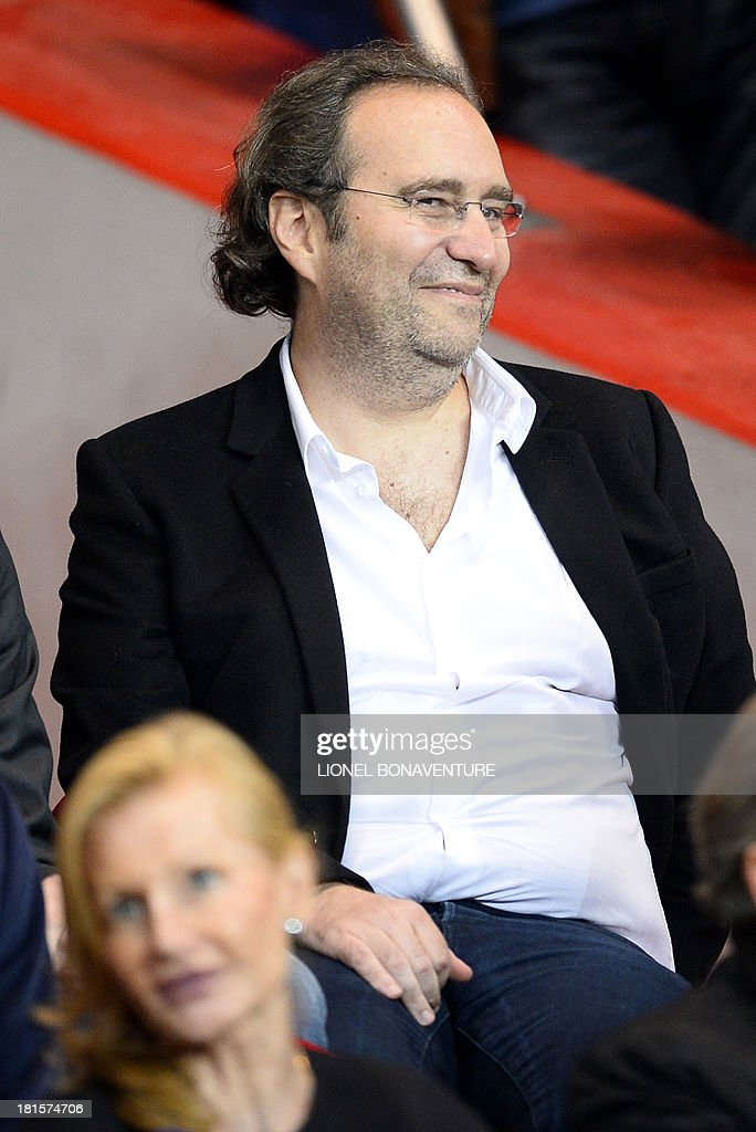 Xavier Niel, founder of the group Iliad and shareholder of French newspaper Le Monde, attends the French L1 football match between Paris Saint-Germain and AS Monaco at the Parc des Princes Stadium in Paris on September 22, 2013.