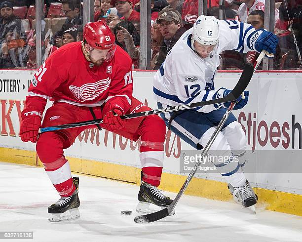 Xavier Ouellet of the Detroit Red Wings battles for the puck along the boards with Connor Brown of the Toronto Maple Leafs during an NHL game at Joe...