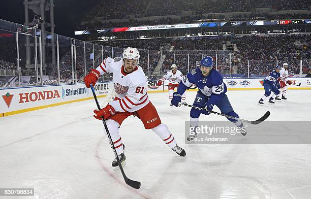 Xavier Ouellet of the Detroit Red Wings skates against James van Riemsdyk of the Toronto Maple Leafs during the 2017 Scotiabank NHL Centennial...
