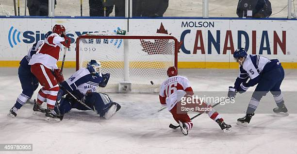 DETROIT MI DECEMBER 30 Xavier Ouellet watches the puck get past Drew MacIntyre as the Toronto Marlies play the Grand Rapid Griffins outside at...
