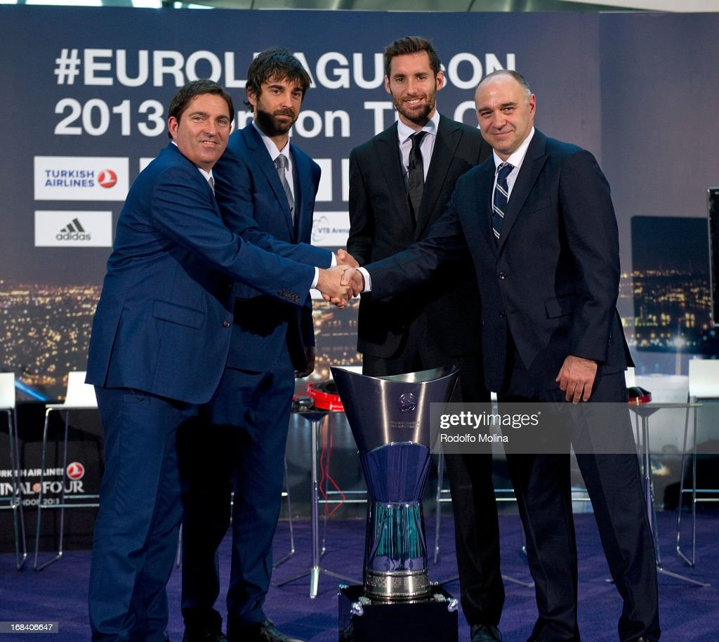 Xavier Pascual, Head Coach of FC Barcelona Regal; Juan Carlos Navarro, #11; Rudy Fernandez, #5 of Real Madrid and Pablo Laso, Head Coach poses with Champion Trophy at the end of the Turkish Airlines EuroLeague Final Four Presentation Press Conference at London City Hall on May 9, 2013 in London, United Kingdom.