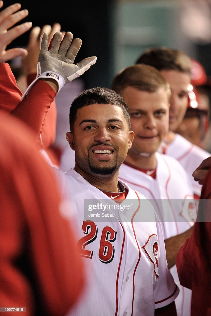 Xavier Paul #26 of the Cincinnati Reds celebrates in the dugout his pinch-hit grand slam home run in the seventh inning against the Washington Nationals at Great American Ball Park on April 5, 2013 in Cincinnati, Ohio. Cincinnati defeated Washington 15-0.