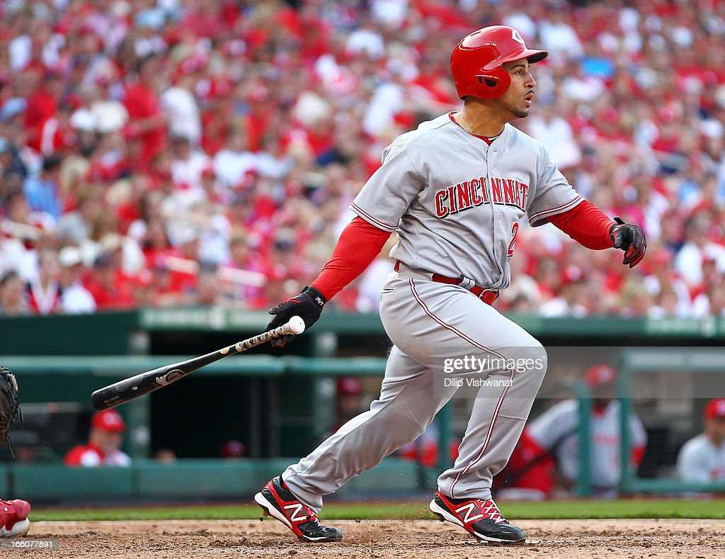 Xavier Paul #26 of the Cincinnati Reds drives in a run to tie the game against the St. Louis Cardinals during Opening Day on April 8, 2013 at Busch Stadium in St. Louis, Missouri.