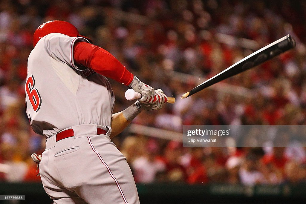 Xavier Paul #26 of the Cincinnati Reds drives in a run with a sacrifice RBI against Adam Wainwright #50 of the St. Louis Cardinals in the fourth inning at Busch Stadium on April 29, 2013 in St. Louis, Missouri. The Reds beat the Cardinals 2-1.