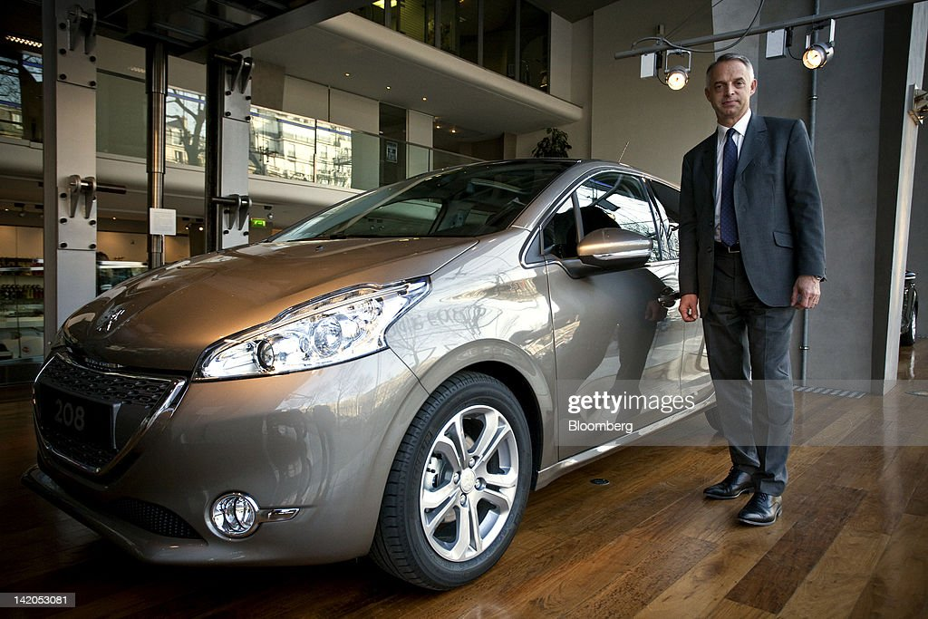 Xavier Peugeot, product director for the Peugeot SA brand, poses for a photograph alongside the new Peugeot 208 automobile, produced by PSA Peugeot Citroen SA, at the company's headquarters in Paris, France, on Wednesday, March 28, 2012. PSA Peugeot Citroen SA, Europe's second-biggest carmaker, seeks leadership in the region's small-car segment with its new 208 model. Photographer: Balint Porneczi/Bloomberg via Getty Images