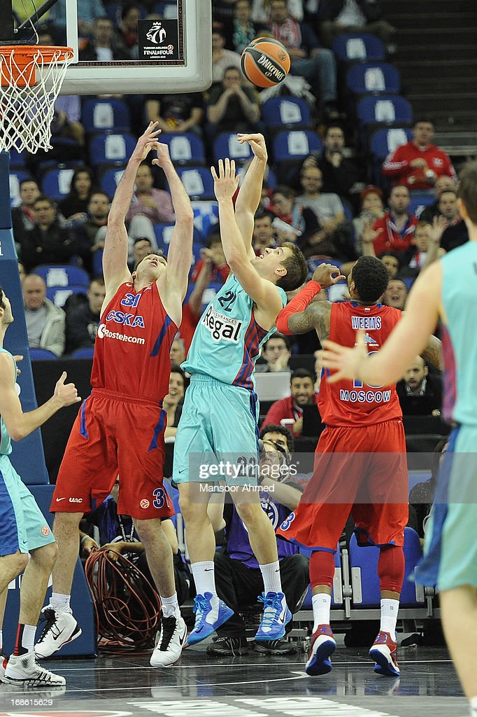 Xavier Rabaseda #22 of FC Barcelona Regal competes with Viktor Khryapa #31 of CSKA Moscow during the Turkish Airlines EuroLeague Final Four game 3rd...