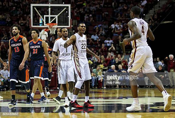 Xavier RathanMayes celebrates with Dwayne Bacon of the Florida State Seminoles during the final seconds of the game against the Virginia Cavaliers at...