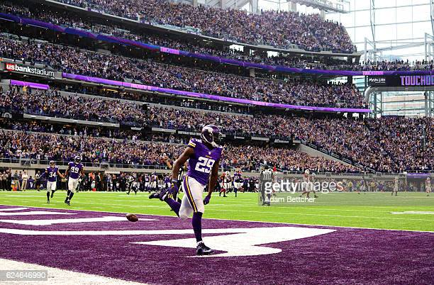 Xavier Rhodes of the Minnesota Vikings celebrates a touchdown after a 100 yard interception return in the second quarter of the game against the...