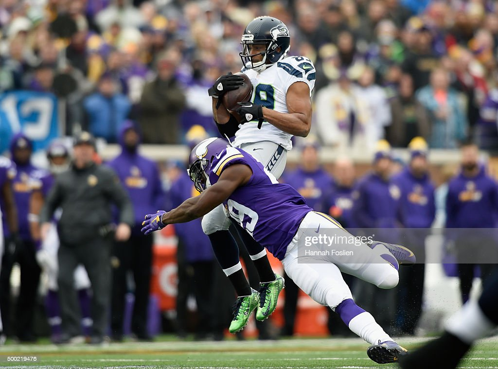 Xavier Rhodes #29 of the Minnesota Vikings tackles Doug Baldwin #89 of the Seattle Seahawks after a reception during the second quarter of the game on December 6, 2015 at TCF Bank Stadium in Minneapolis, Minnesota.