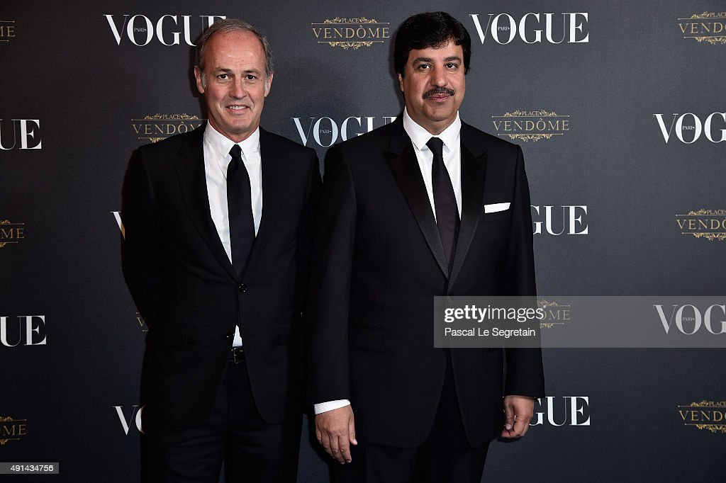 Xavier Romatet and Abdul Aziz Mohammed Al Rabban attends the Vogue 95th Anniversary Party on October 4, 2015 in Paris, France.