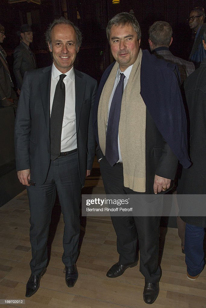 Xavier Romatet (L) and Olivier Labesse attend the Berluti Men Autumn / Winter 2013 presentation at the Great Gallery of Evolution in the National Museum of Natural History, as part of Paris Fashion Week on January 18, 2013 in Paris, France.