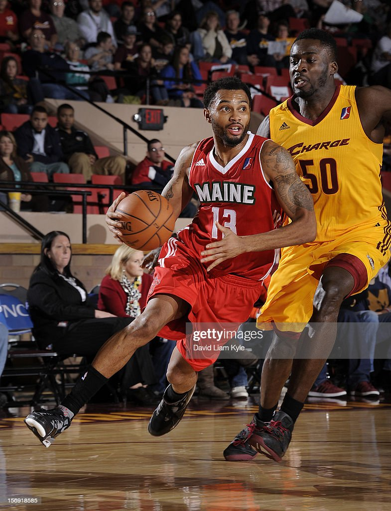 Xavier Silas #13 of the Maine Red Claws drives to the hoop against Michael Eric #50 of the Canton Charge at the Canton Memorial Civic Center on November 23, 2012 in Canton, Ohio.
