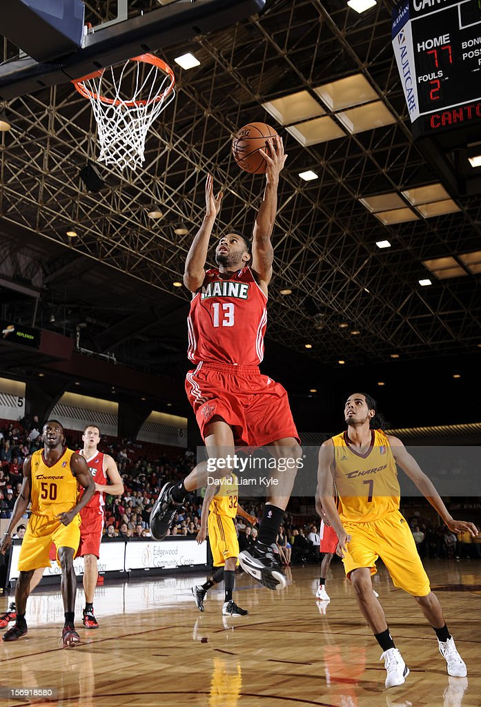 Xavier Silas #13 of the Maine Red Claws puts up the shot against Jorge Gutierrez #7 of the Canton Charge at the Canton Memorial Civic Center on November 23, 2012 in Canton, Ohio.