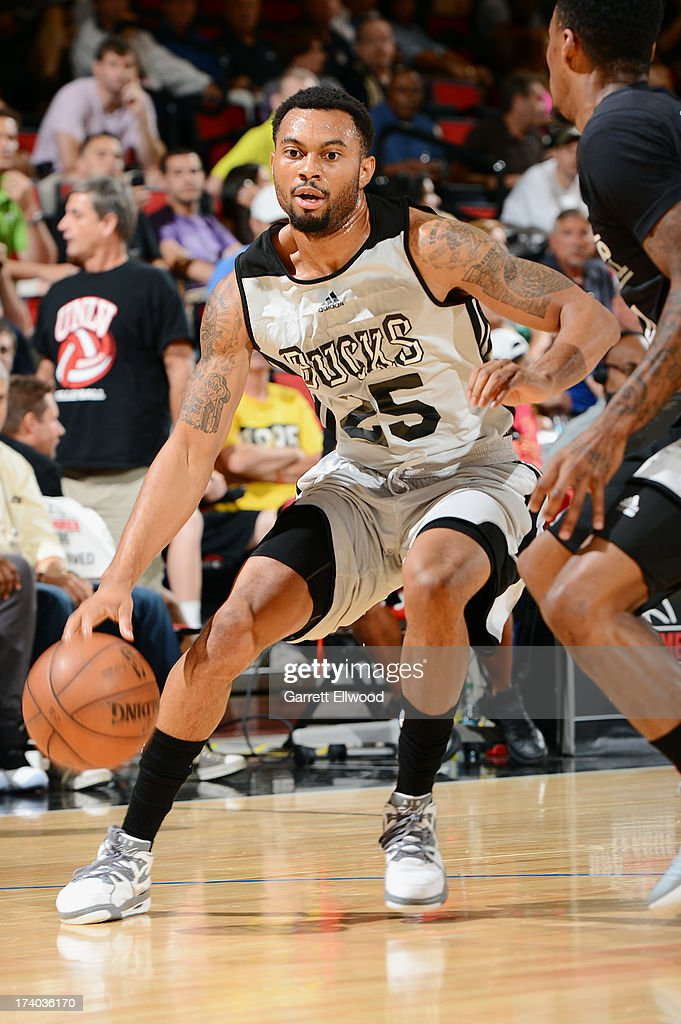 Xavier Silas #25 of the Milwaukee Bucks dribbles the ball versus the San Antonio Spurs during NBA Summer League on July 19, 2013 at the Cox Pavilion in Las Vegas, Nevada.