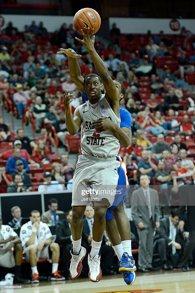 Xavier Thames #2 of the San Diego State Aztecs gets fouled by the Boise State Broncos during a quarterfinal game of the Reese's Mountain West Conference Basketball tournament at the Thomas & Mack Center on March 13, 2013 in Las Vegas, Nevada. SDSU won 73-67.