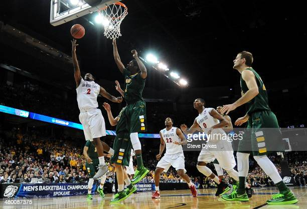 Xavier Thames of the San Diego State Aztecs goes up against the North Dakota State Bison during the Third Round of the 2014 NCAA Basketball...
