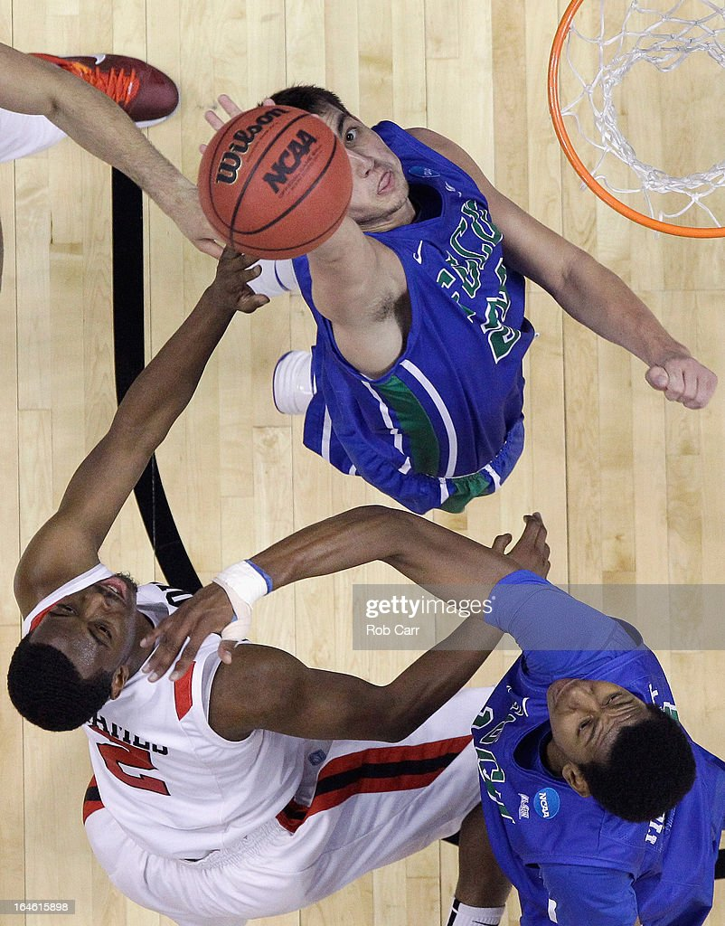 Xavier Thames #2 of the San Diego State Aztecs puts up a shot against the defense of Chase Fieler #20 and Eric McKnight #12 of the Florida Gulf Coast Eagles during the Third Round of the 2013 NCAA Men's Basketball Tournament on March 24, 2013 at Wells Fargo Center in Philadelphia, Pennsylvania.