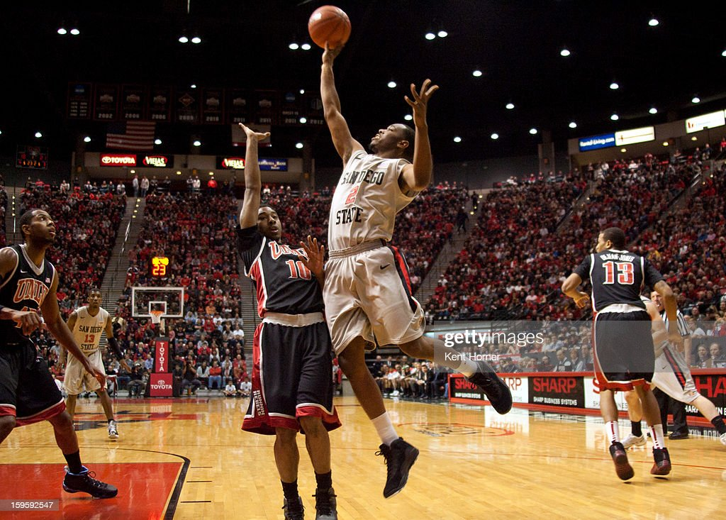 Xavier Thames #2 of the San Diego State Aztecs shoots the ball in the first half of the game over Daquan Cook #10 of the UNLV Runnin' Rebels at Viejas Arena on January 16, 2013 in San Diego, California.